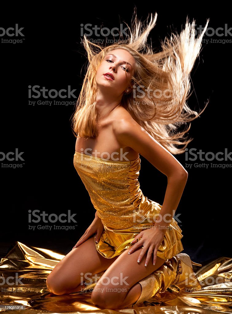 Sexy dancer in gold royalty-free stock photo