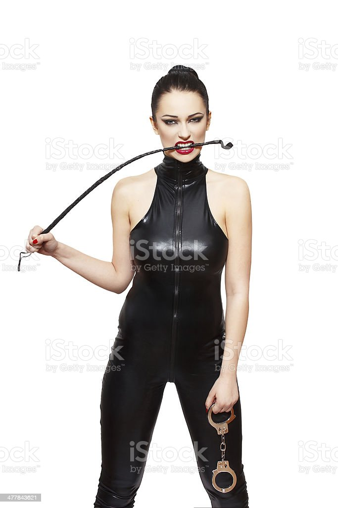 Sexy dominatrix with whip and handcuffs stock photo