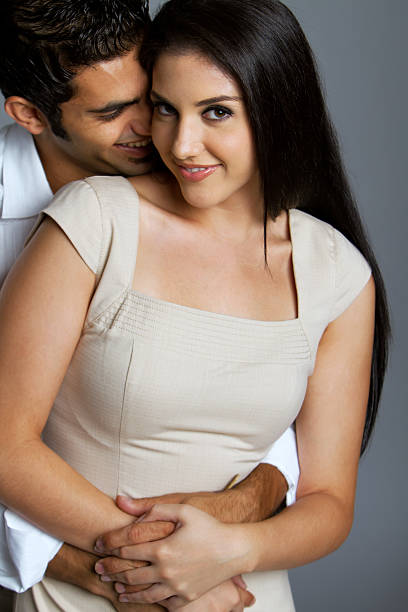 Sexy ethnic couple in love stock photo