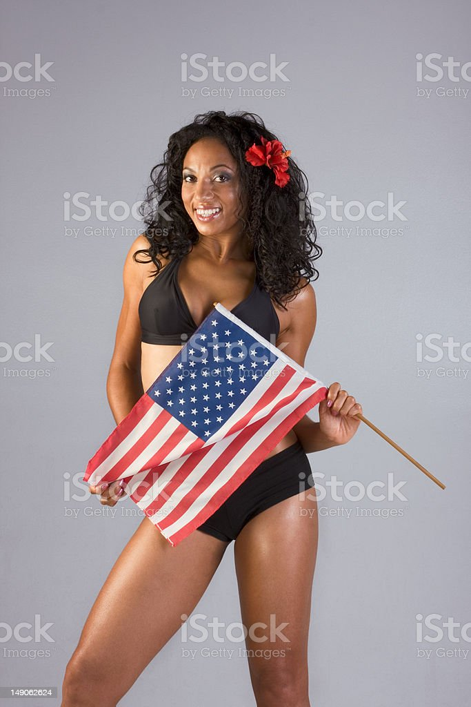 Sexy ethnic woman wrapped in American national flag royalty-free stock photo