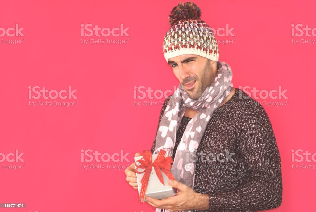 sexy face man holding gift box stock photo
