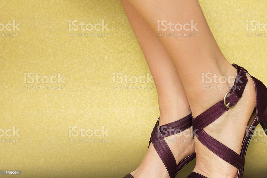 Sexy Feet in Satin Sandals Woman's feet in purple satin sandals on a gold background Adult Stock Photo