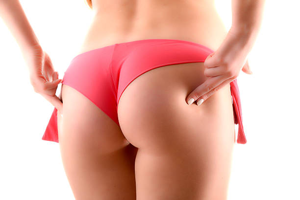 sexy female buttocks isolated on white background - beautiful curvy girls stock photos and pictures