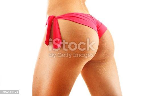 521792745istockphoto Sexy female buttocks isolated on white background 534511171