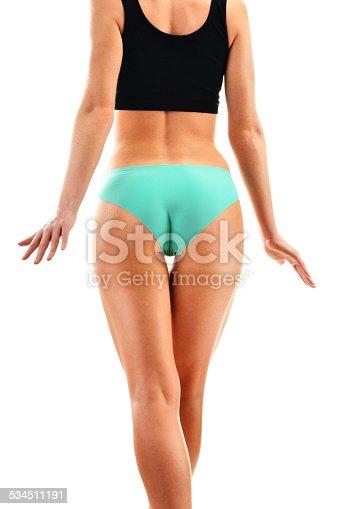 521792745istockphoto Sexy female buttocks isolated on white background 534511191