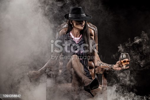 Sexy brunette female gangster boss