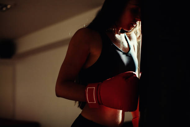 sexy fighter girl in gym with boxing bag – Foto