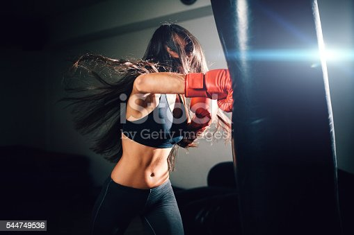 istock sexy fighter girl punching actively 544749536