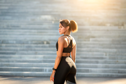 Sexy african fitness model posing over stairs at park, copy space