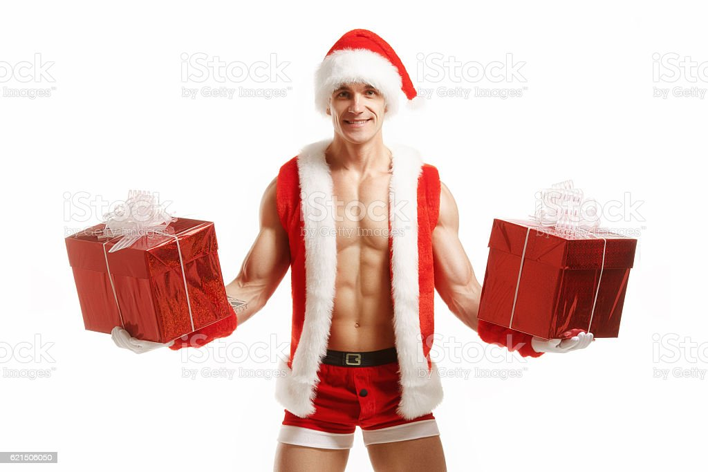 Sexy fitness Santa Claus holding a red boxes foto stock royalty-free