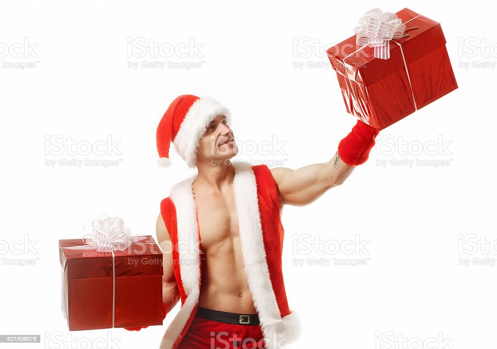 Sexy fitness Santa Claus holding a red boxes photo libre de droits