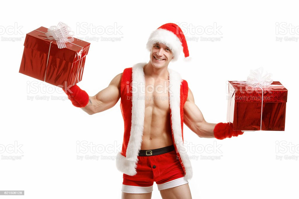 Sexy fitness Santa Claus holding a red boxes Lizenzfreies stock-foto