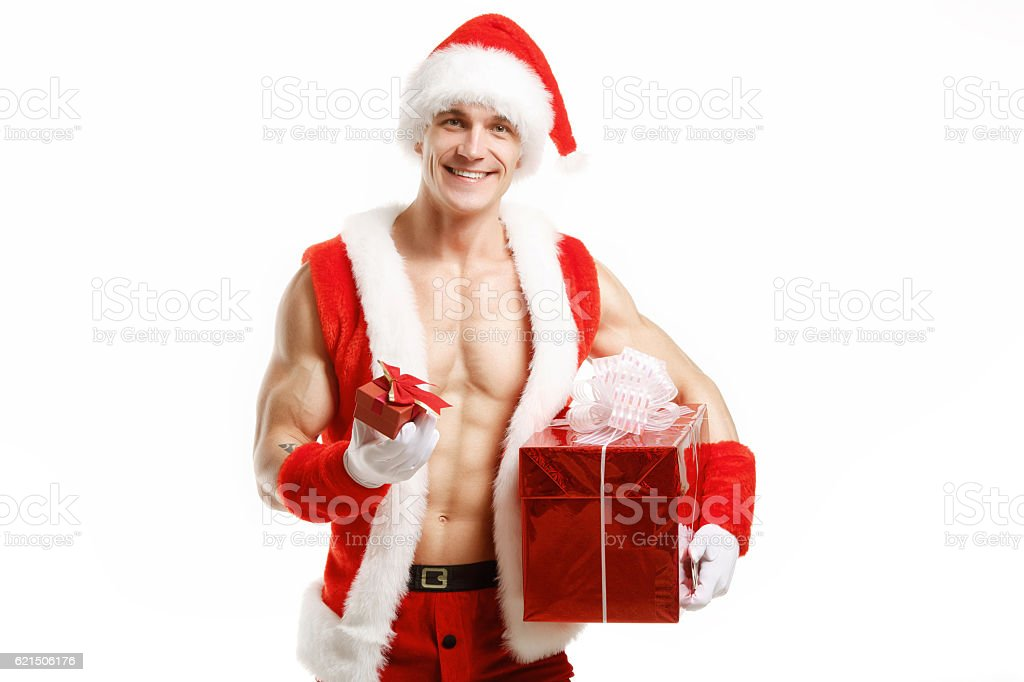 Sexy fitness Santa Claus holding a red boxes photo libre de droits