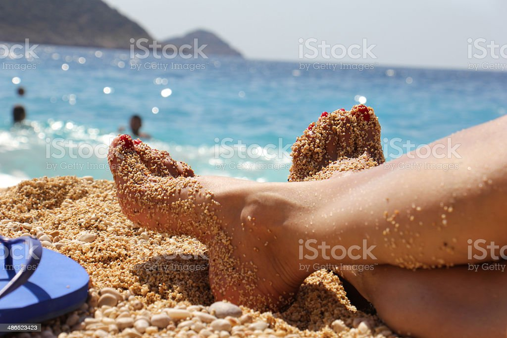 Sexy Foot On The Beach stock photo
