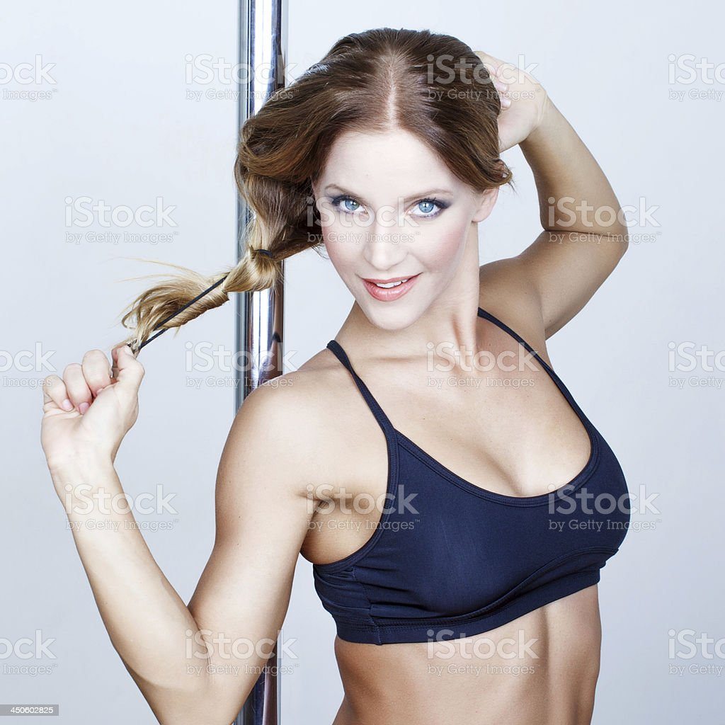 Sexy fresh pole dancer striptease royalty-free stock photo