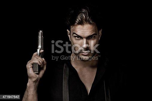 istock sexy gangster holding gun 471947542