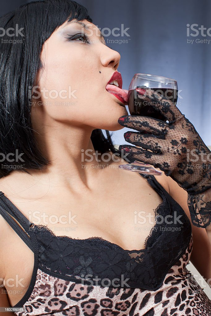 Sexy Gangster is drinking wine like blood stock photo
