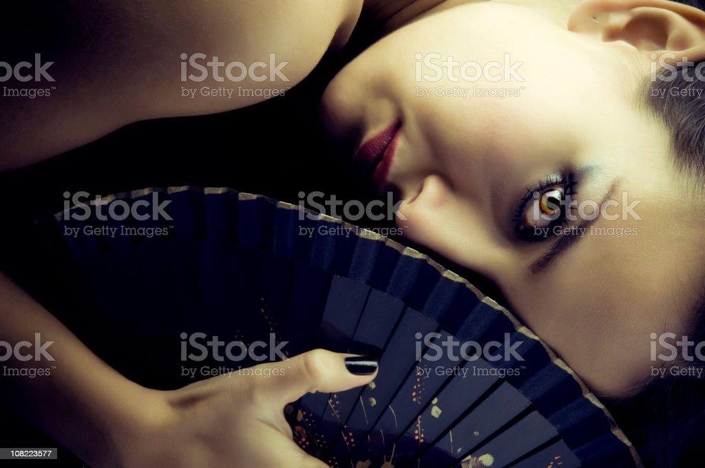 Sexy geisha with fan royalty-free stock photo