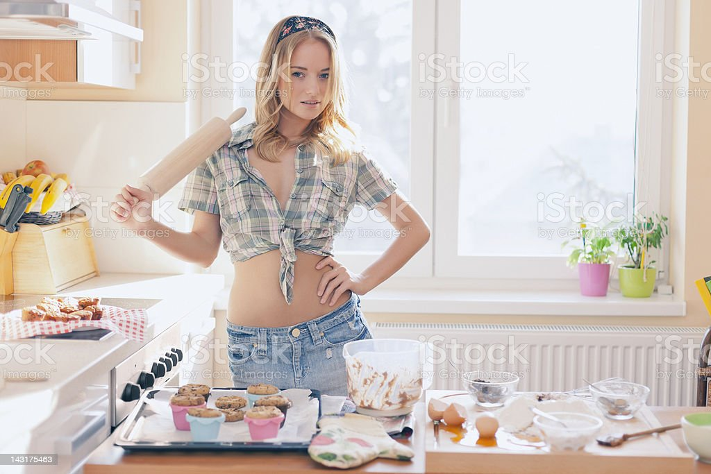 Sexy girl baking in the kitchen royalty-free stock photo