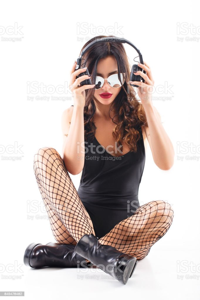 sexy girl DJ in top and pantyhose stock photo