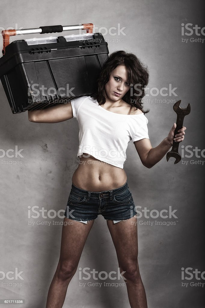 Sexy girl holding toolbox and wrench spanner stock photo