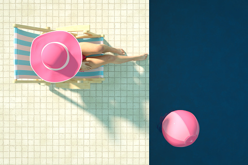 3d rendering of swimming pool. Summer Concept. Travel destinations. Sexy girl in a pink color bikini sunbathing in the pool. Beach Ball. Aerial view.