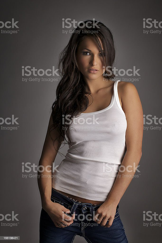 f3888a6525492 Sexy Girl in a White Tank Top stock photo
