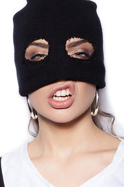 sexy girl in balaclava - crime and violence stock photo