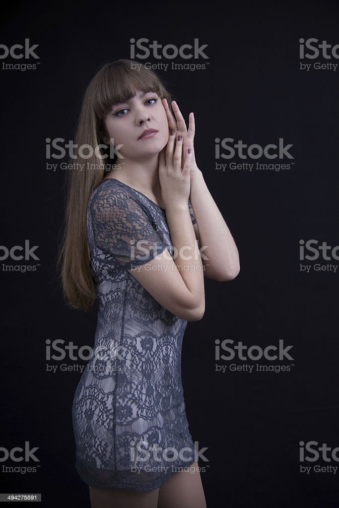Sexy girl in lace dress Sexy girl in a lace dress on a black background Adult Stock Photo