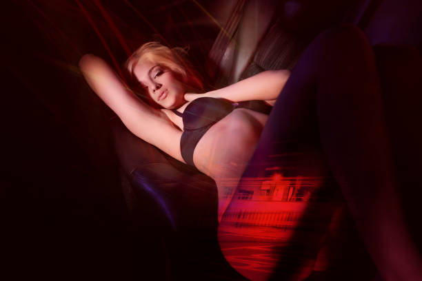 Beautiful Blond Young Woman in Sexy Lingerie, Back of Car stock photo