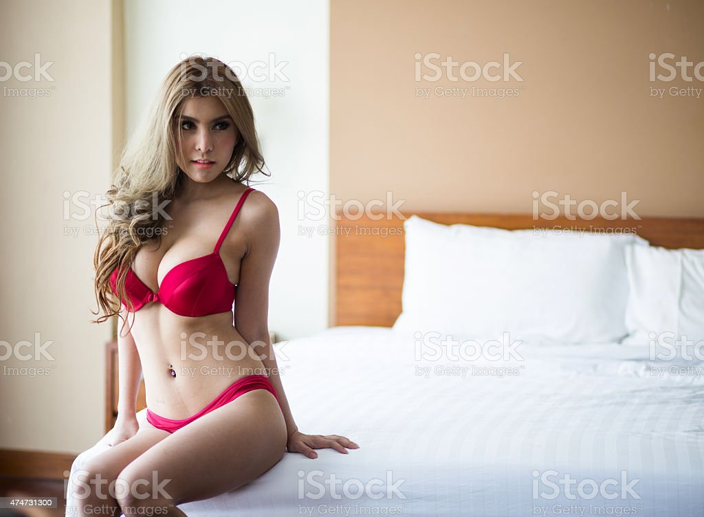 Sexy girl in red underwear stock photo