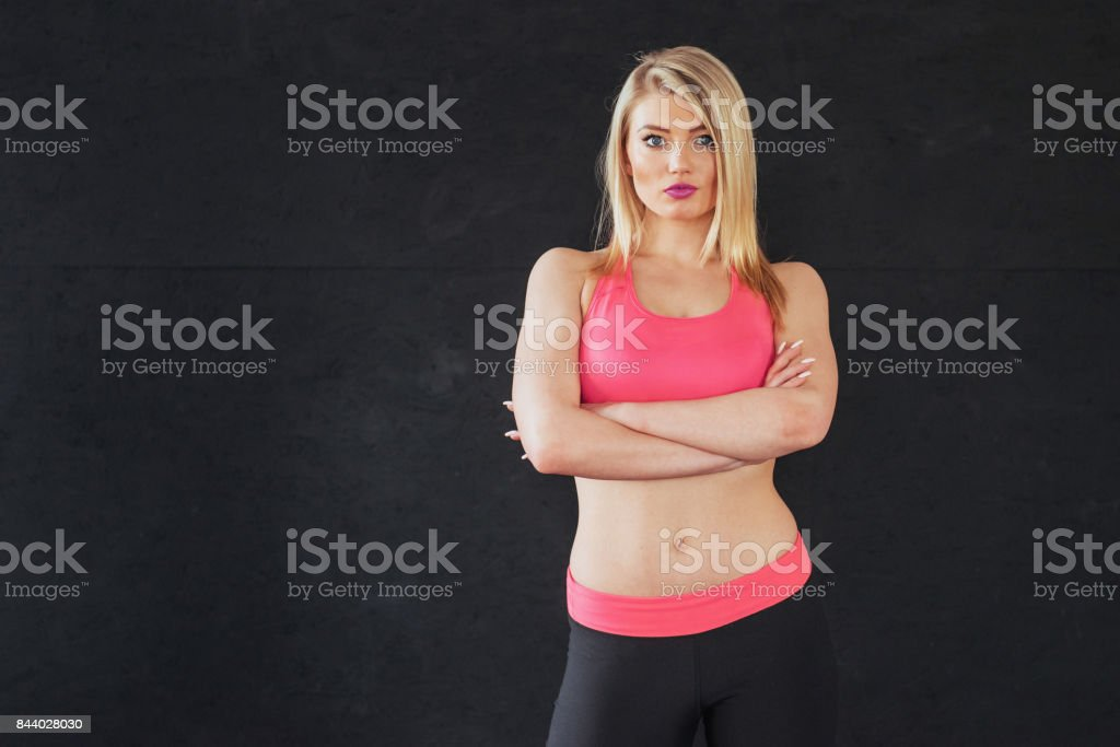 Sexy girl in sportswear with a smile posing for the camera in a sports hall stock photo