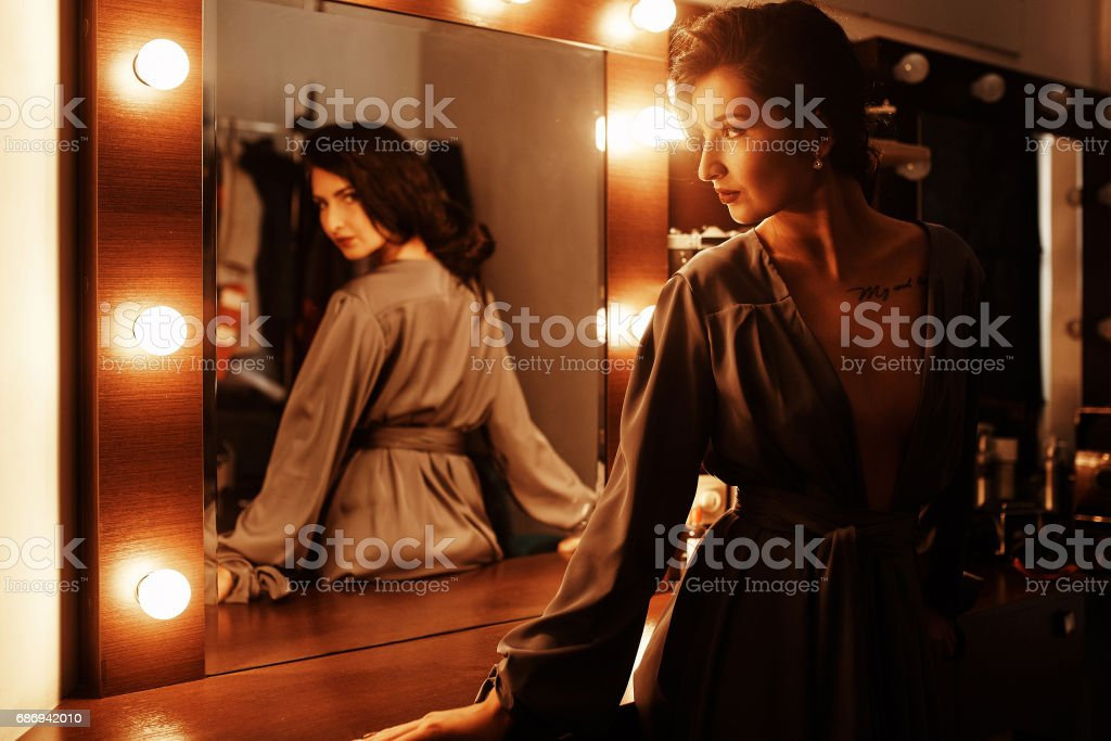 Sexy girl near the mirror in the dressing room stock photo