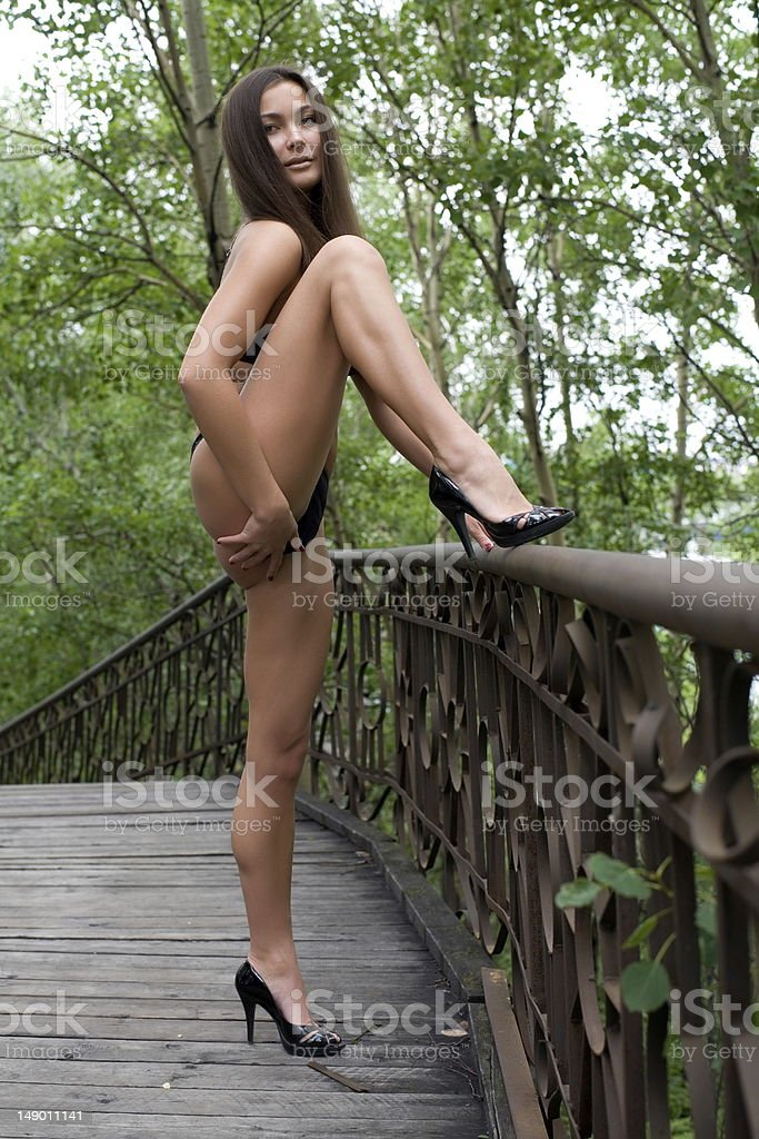 Sexy girl on a pedestrian bridge stock photo