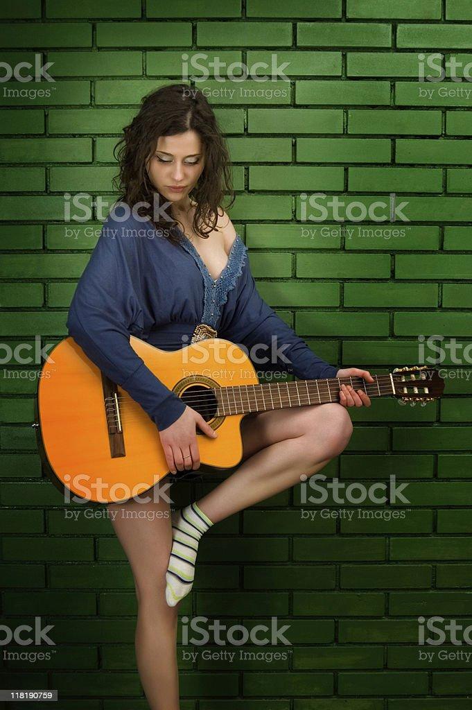 Sexy Girl playing Guitar stock photo