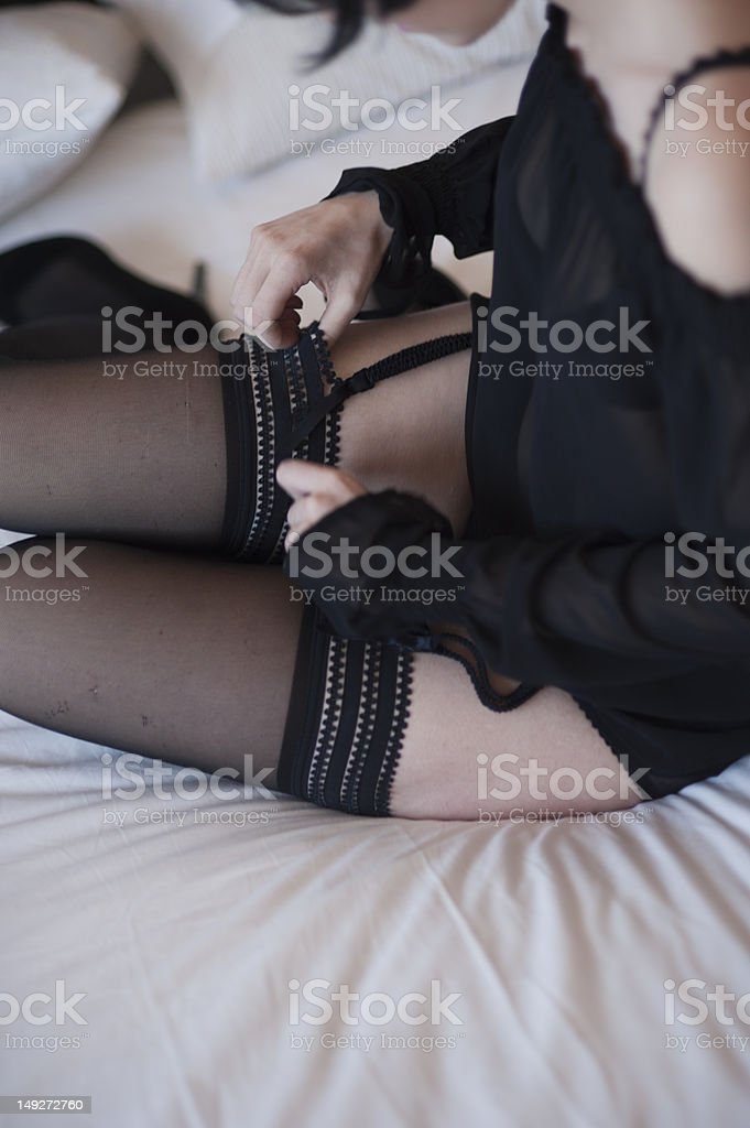 Sexy girl putting her stockings on stock photo