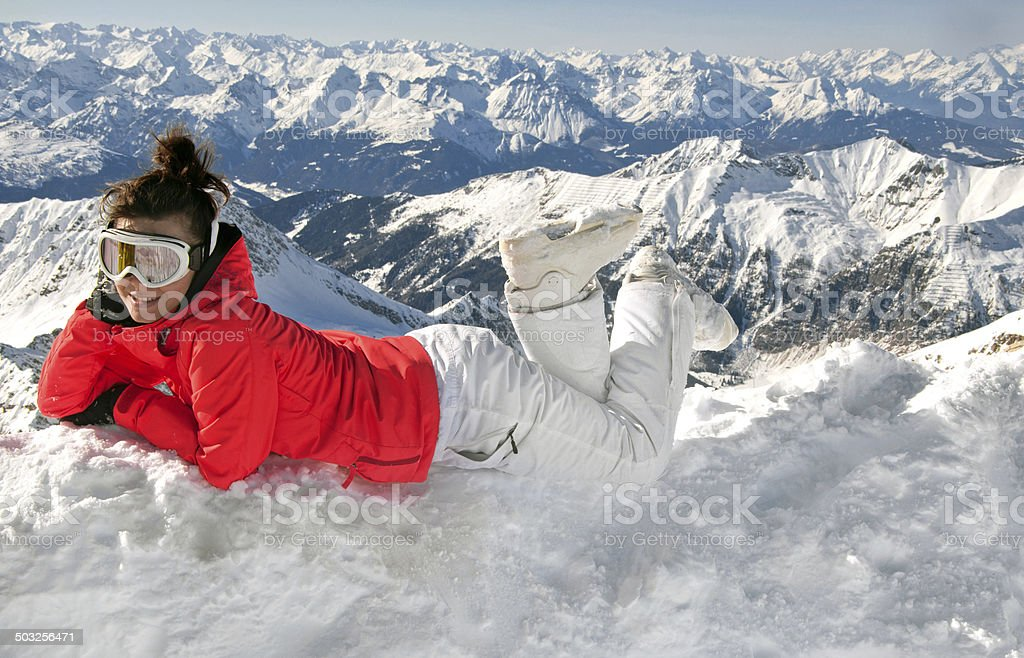 Sexy girl resting from skiing on top of mountain stock photo