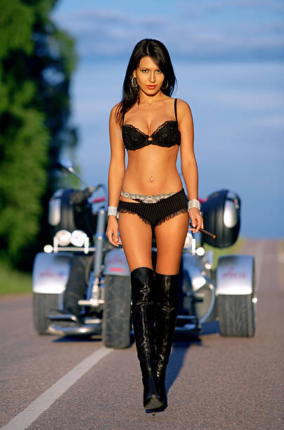Sexy girl with motorbike stock photo