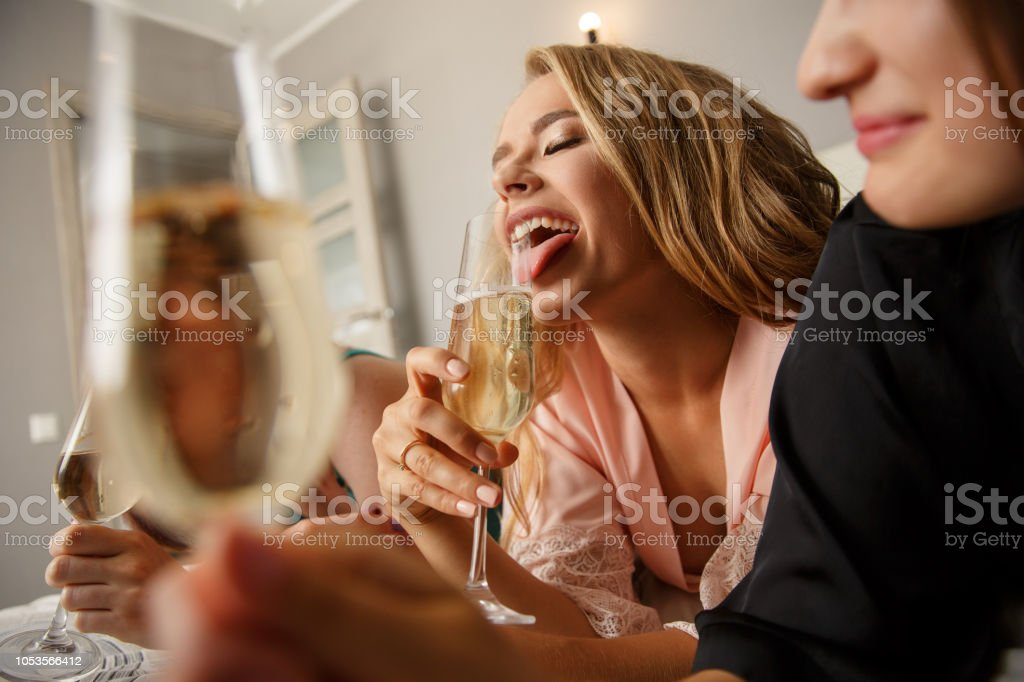 Sexy girls drinking a champagne, while celebrating a bridal shower stock photo