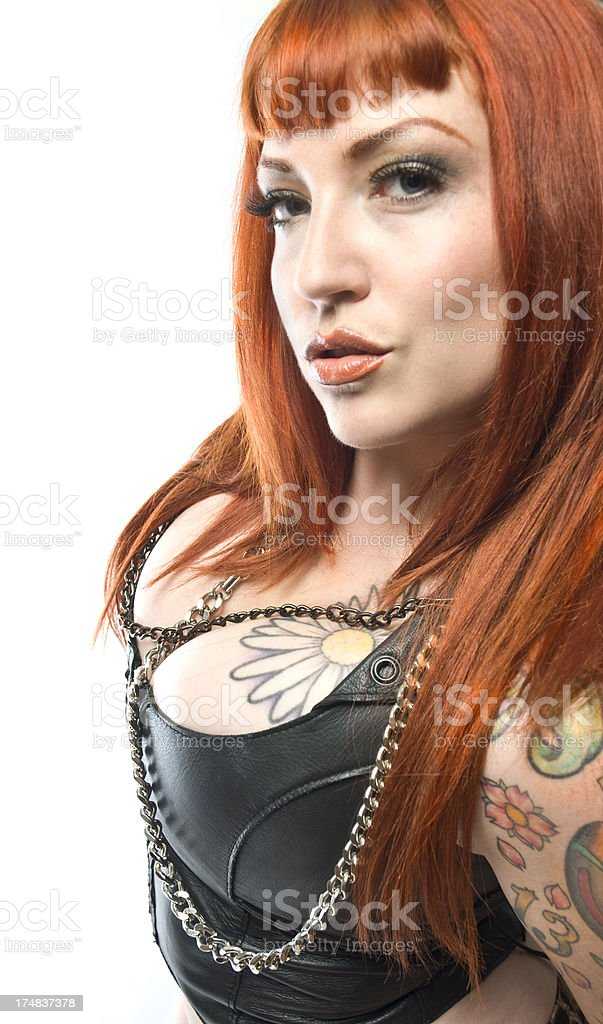 Sexy Goth Red Hair Tattoo Female With Bangs And Cleavage royalty-free stock photo