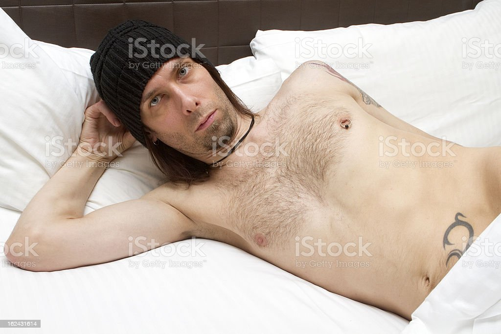 Sexy Guy Under The Sheets stock photo