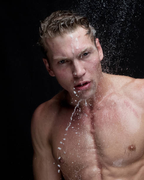 Sexy headshot of man taking a shower stock photo