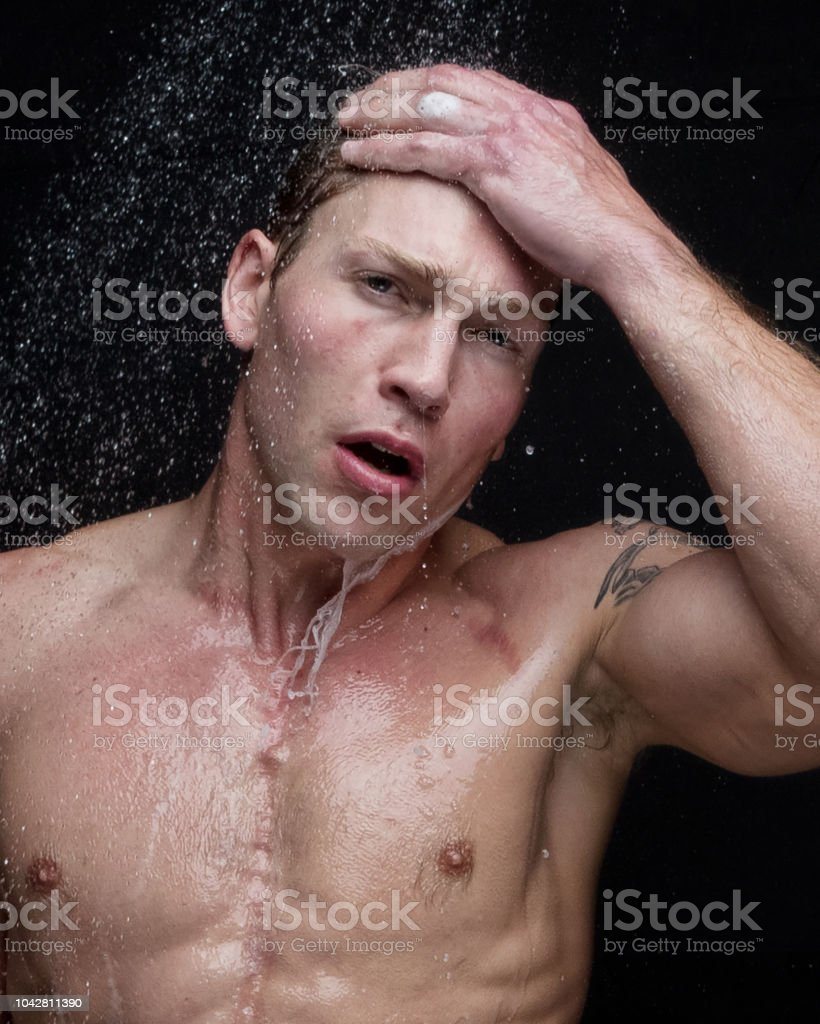 Sexy headshot of man taking a shower stock photo