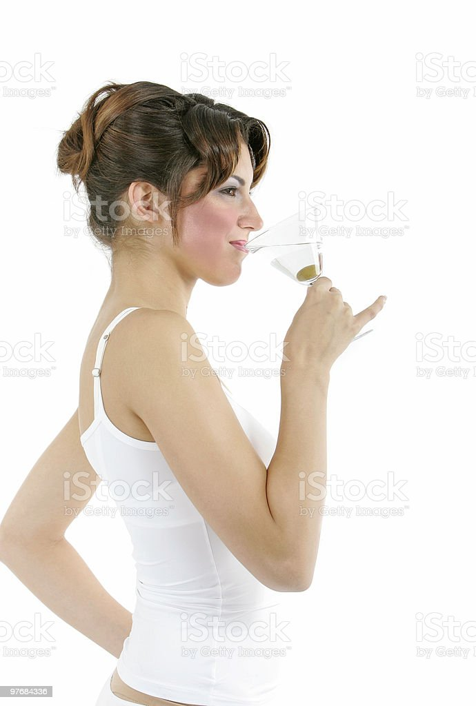 Sexy healthy woman with a glass of martini and an olive royalty-free stock photo