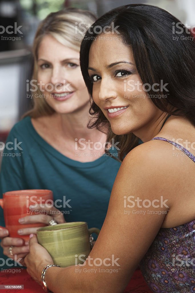 Sexy Hispanic Woman and Friend in Cafe royalty-free stock photo