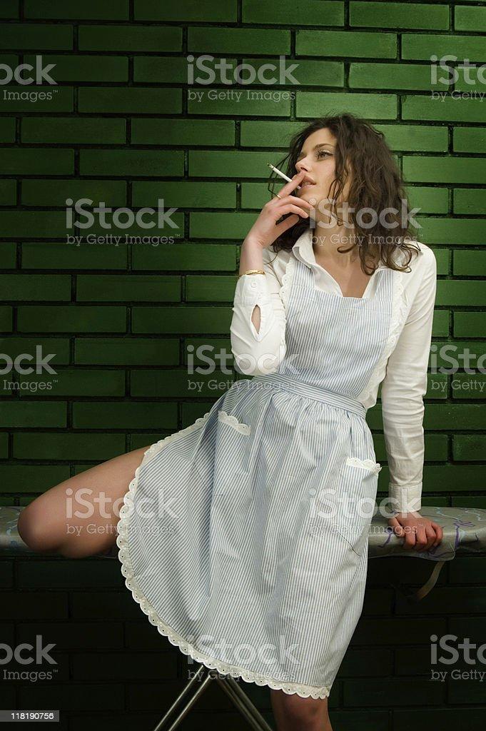 Sexy Housemaid Smoking stock photo