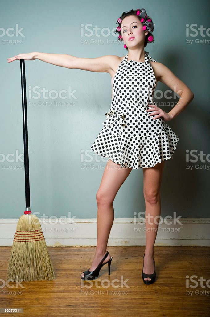 Sexy housewife with curlers royalty-free stock photo