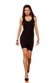 young beautiful lady walking in short black tight dress