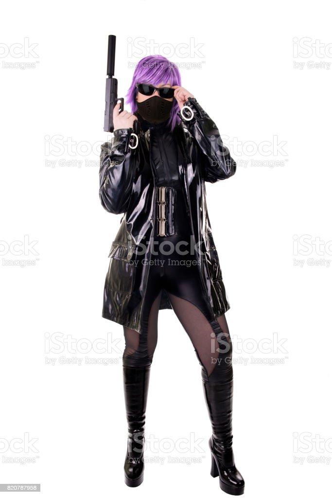 Sexy killer holding gun stock photo