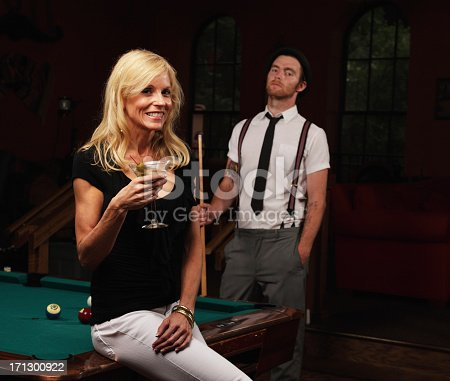 This sexy lady with a tipsy martini doesn't appear to be paying enough attention to her jealous pool player boyfriend. Or maybe he's just annoyed she has interrupted his game?